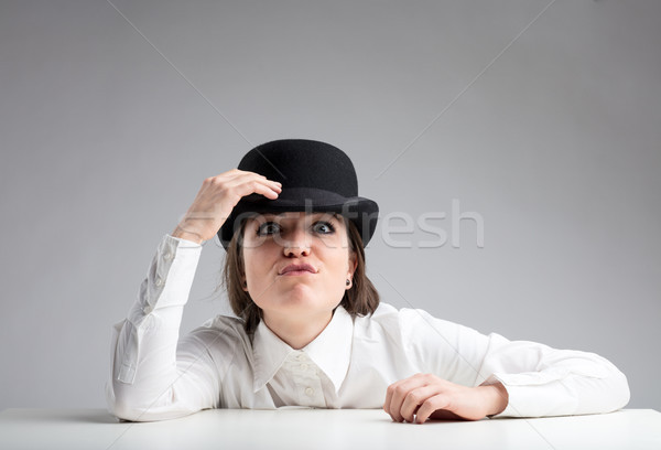 funny insolent expression of a woman in bowler Stock photo © Giulio_Fornasar