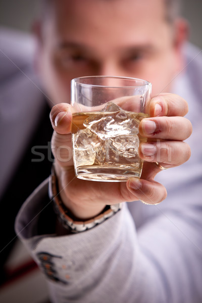 glass of alcoholic drink in man's hand Stock photo © Giulio_Fornasar