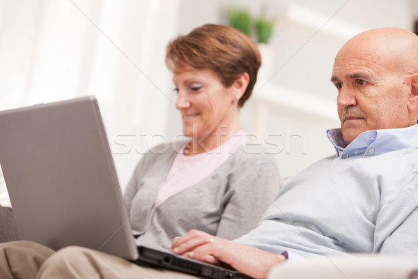 mature couple using mobile devices Stock photo © Giulio_Fornasar
