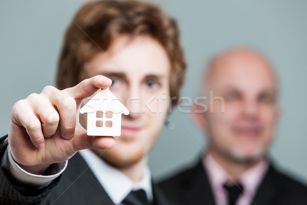 Close up on little house symbol held by man Stock photo © Giulio_Fornasar