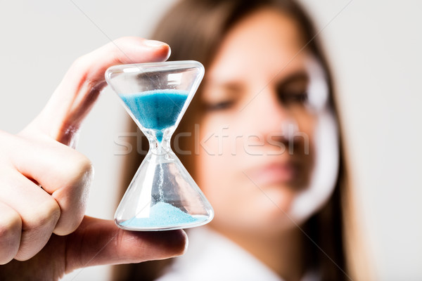 hourglass held by a concerned woman Stock photo © Giulio_Fornasar