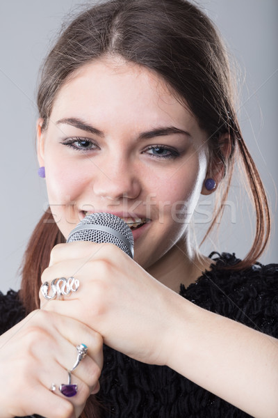 girl holding a microphone and singing Stock photo © Giulio_Fornasar