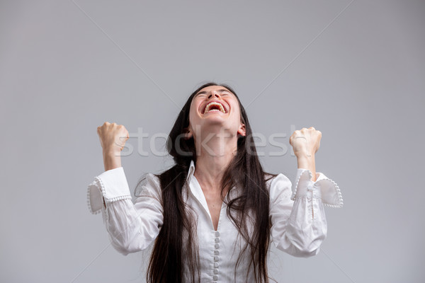 Jubilant woman laughing and clenching her fists Stock photo © Giulio_Fornasar