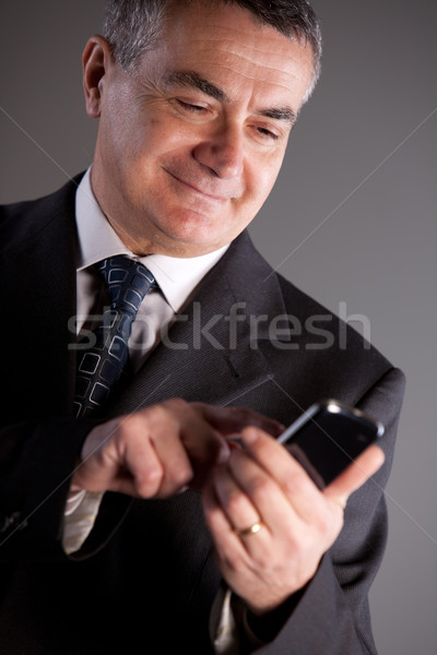 Stock photo: I'm an expert manager with my mobile phone