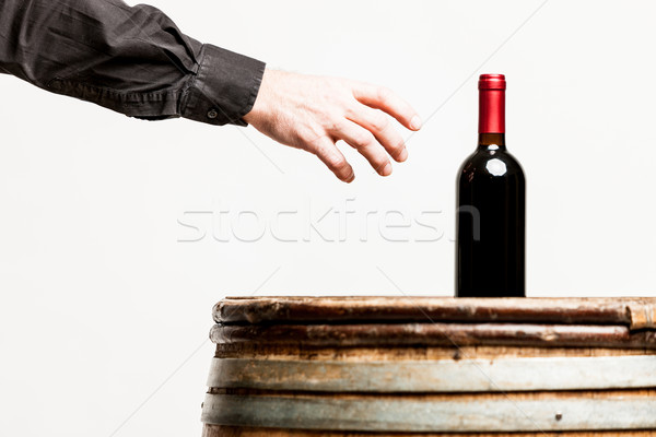 hand of a man about to grasp a wine bottle Stock photo © Giulio_Fornasar