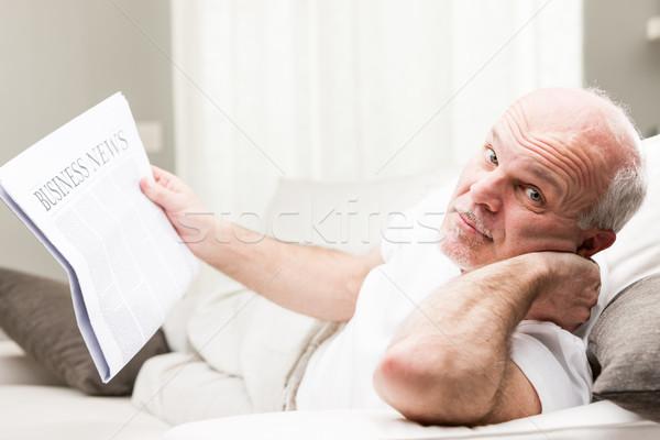 relaxed senior man reading business news Stock photo © Giulio_Fornasar