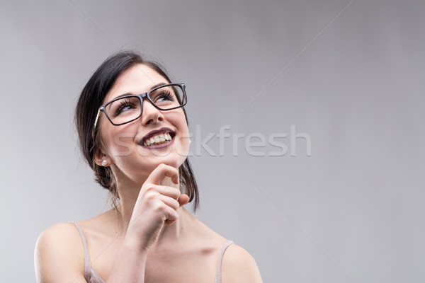 Happy attractive young woman standing daydreaming Stock photo © Giulio_Fornasar