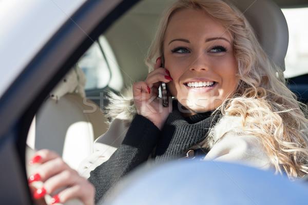 smiling woman driving while phoning Stock photo © Giulio_Fornasar