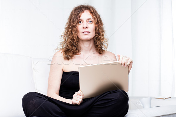 Single calm beautiful woman holding large tablet Stock photo © Giulio_Fornasar