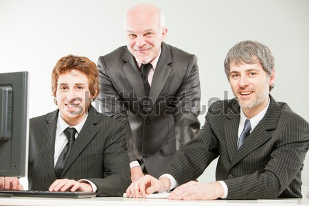 three thrilled businessmen pointing out to you Stock photo © Giulio_Fornasar