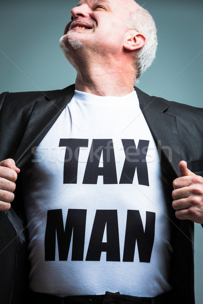Man opening shirt with tax man text Stock photo © Giulio_Fornasar