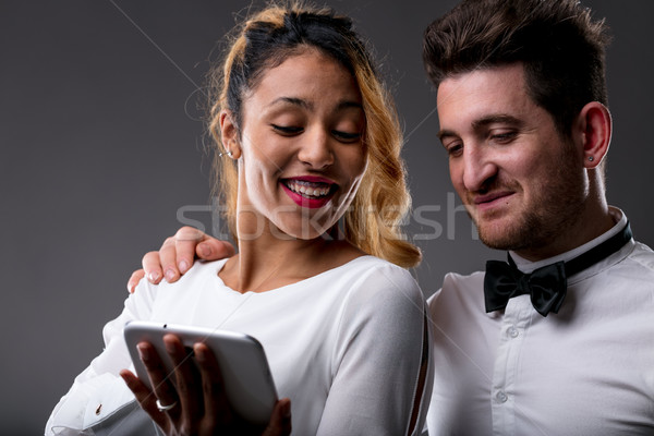 look my dear what a funny thing on the internet Stock photo © Giulio_Fornasar