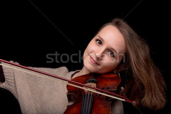 smiling woman playing violin on black background Stock photo © Giulio_Fornasar