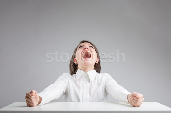 woman with her mouth wide open shouting Stock photo © Giulio_Fornasar