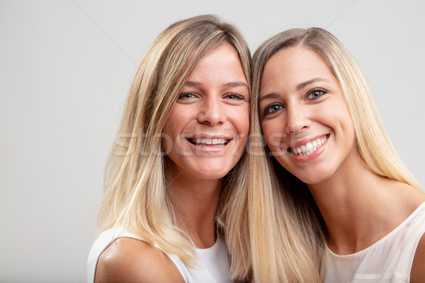 Two happy smiling young blond women Stock photo © Giulio_Fornasar