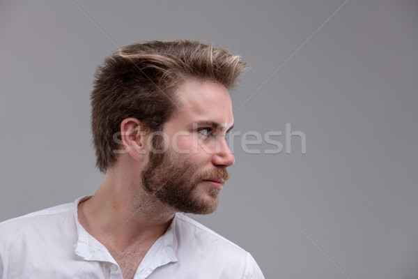 Intense handsome young man looking to the side Stock photo © Giulio_Fornasar