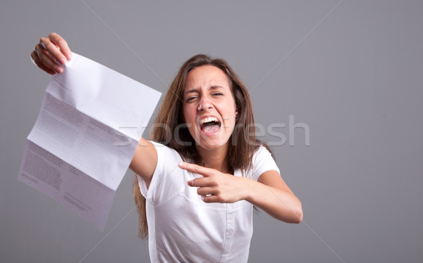 What's this?! Angry girl and bad news Stock photo © Giulio_Fornasar