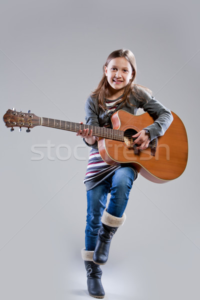 little girl playing acoustic guitar Stock photo © Giulio_Fornasar