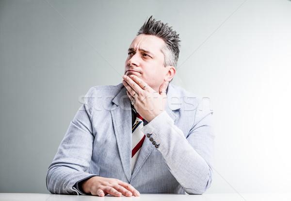Excesso de peso empresário pensando suspeito Foto stock © Giulio_Fornasar