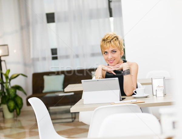 business woman working out of home in a cafeteria Stock photo © Giulio_Fornasar