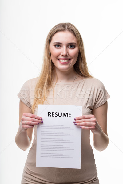 Young woman holding her resume Stock photo © Giulio_Fornasar