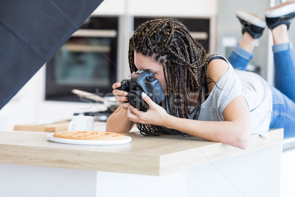 Girl lying on table and photographing pizza Stock photo © Giulio_Fornasar