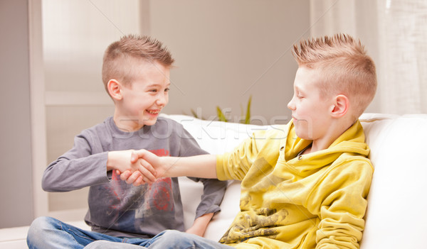 two babies shaking their hands as they were businessmen Stock photo © Giulio_Fornasar