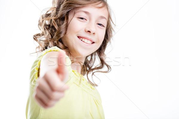 Pequeno menina polegar para cima sorridente Foto stock © Giulio_Fornasar
