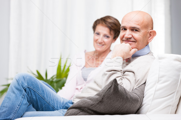 Attractive friendly smiling middle-aged couple Stock photo © Giulio_Fornasar