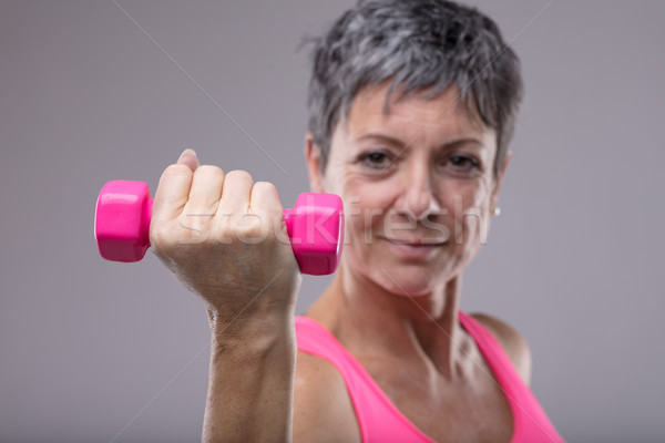 Fit determined woman working out with weights Stock photo © Giulio_Fornasar