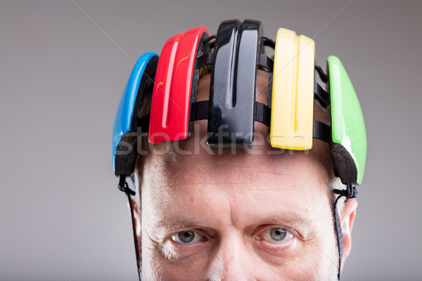 Stock photo: close up of a bike helmet on an old man