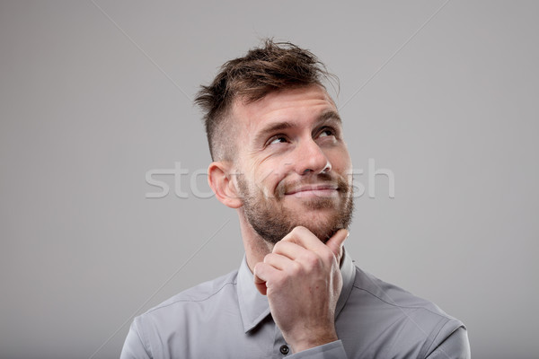 Thoughtful man standing daydreaming Stock photo © Giulio_Fornasar