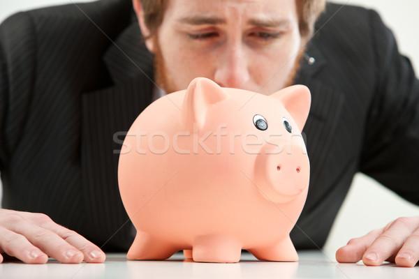 Wreed wereld spaarpot bezorgd jonge zakenman Stockfoto © Giulio_Fornasar
