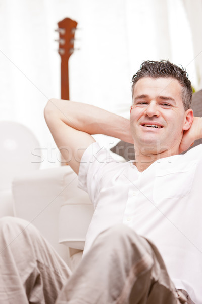 man smiling to camera relaxing in his living room Stock photo © Giulio_Fornasar