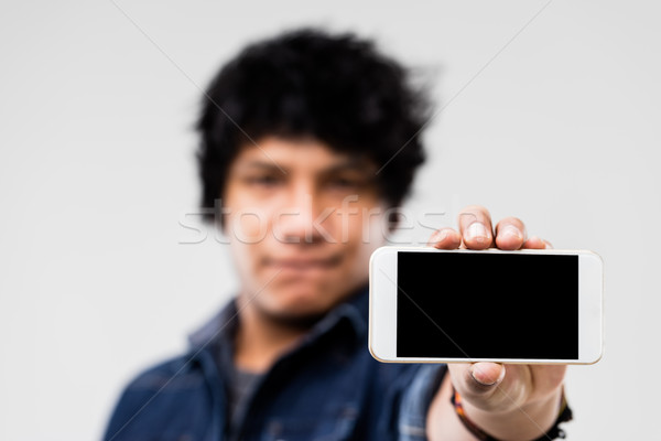 man showing smartphone screen to you Stock photo © Giulio_Fornasar