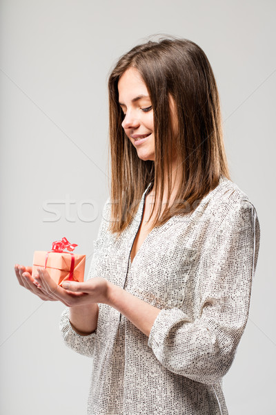 serene smiling woman with a gift in her hands Stock photo © Giulio_Fornasar