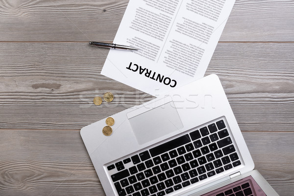 Flat lay of business contract, laptop and money Stock photo © Giulio_Fornasar