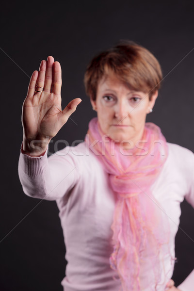 mature woman with a raised closed hand Stock photo © Giulio_Fornasar