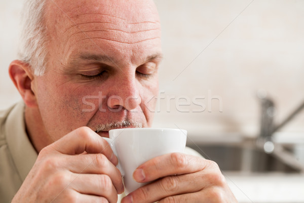 Sleepy man holding little coffee cup to his mouth Stock photo © Giulio_Fornasar