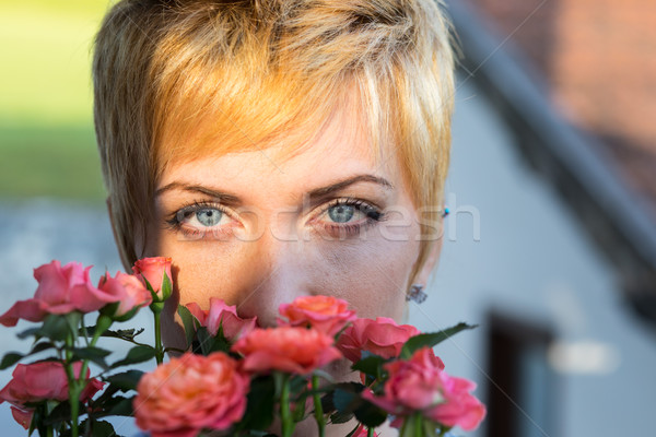 real woman smelling flowers outdoors Stock photo © Giulio_Fornasar