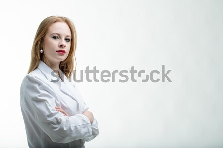Thoughtful young female doctor with folded arms Stock photo © Giulio_Fornasar