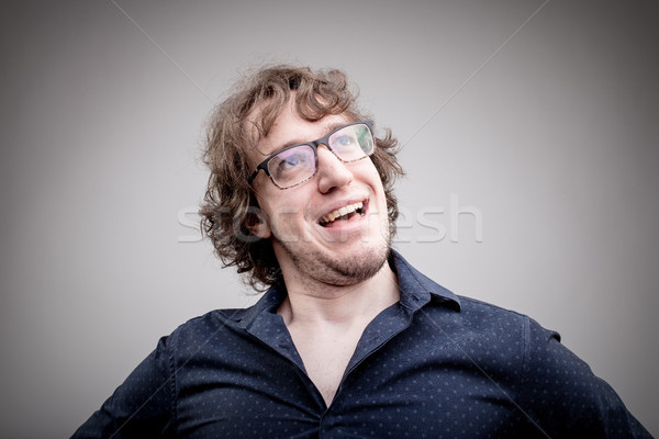 happy and proud man portrait on gray Stock photo © Giulio_Fornasar