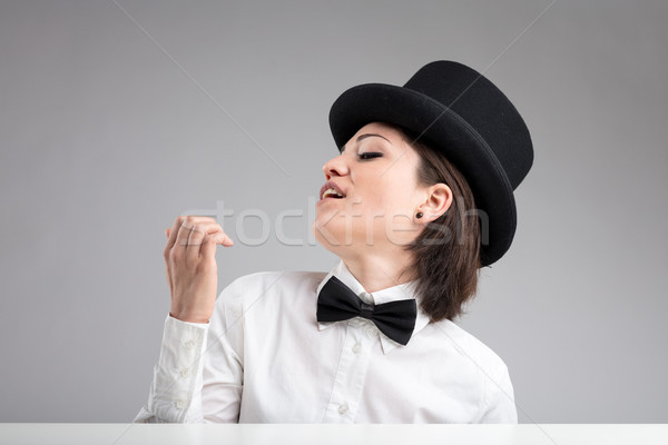 vain woman in top hat showing herself off Stock photo © Giulio_Fornasar