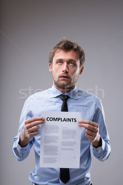 Man rolling his eyes over a Complaints notice Stock photo © Giulio_Fornasar