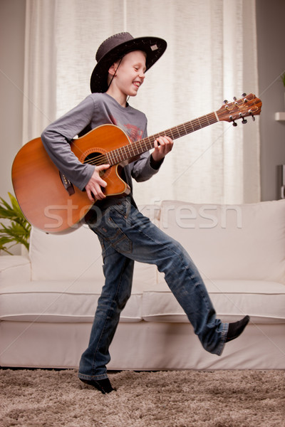 little boy is very good at playing guitar Stock photo © Giulio_Fornasar