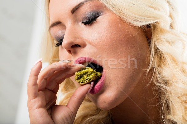 woman eating macaron and falling in love with it Stock photo © Giulio_Fornasar