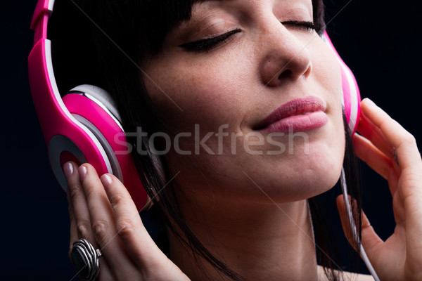 Female with closed eyes and grin using headphones Stock photo © Giulio_Fornasar