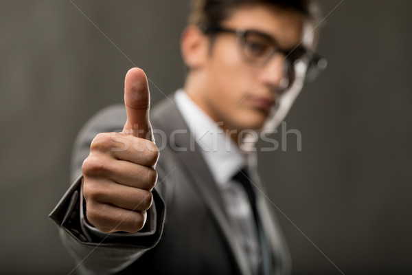handsome young business man showing thumbs up Stock photo © Giulio_Fornasar