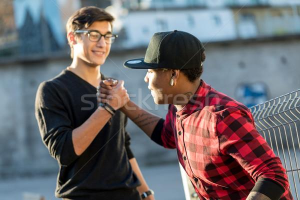 Goede vrienden grapje geheime handdruk hand Stockfoto © Giulio_Fornasar