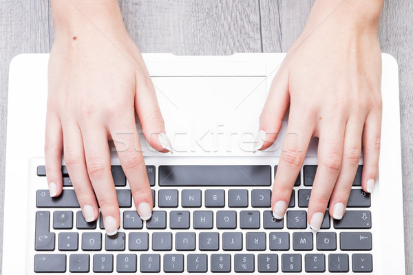 Woman typing on a laptop keyboard Stock photo © Giulio_Fornasar
